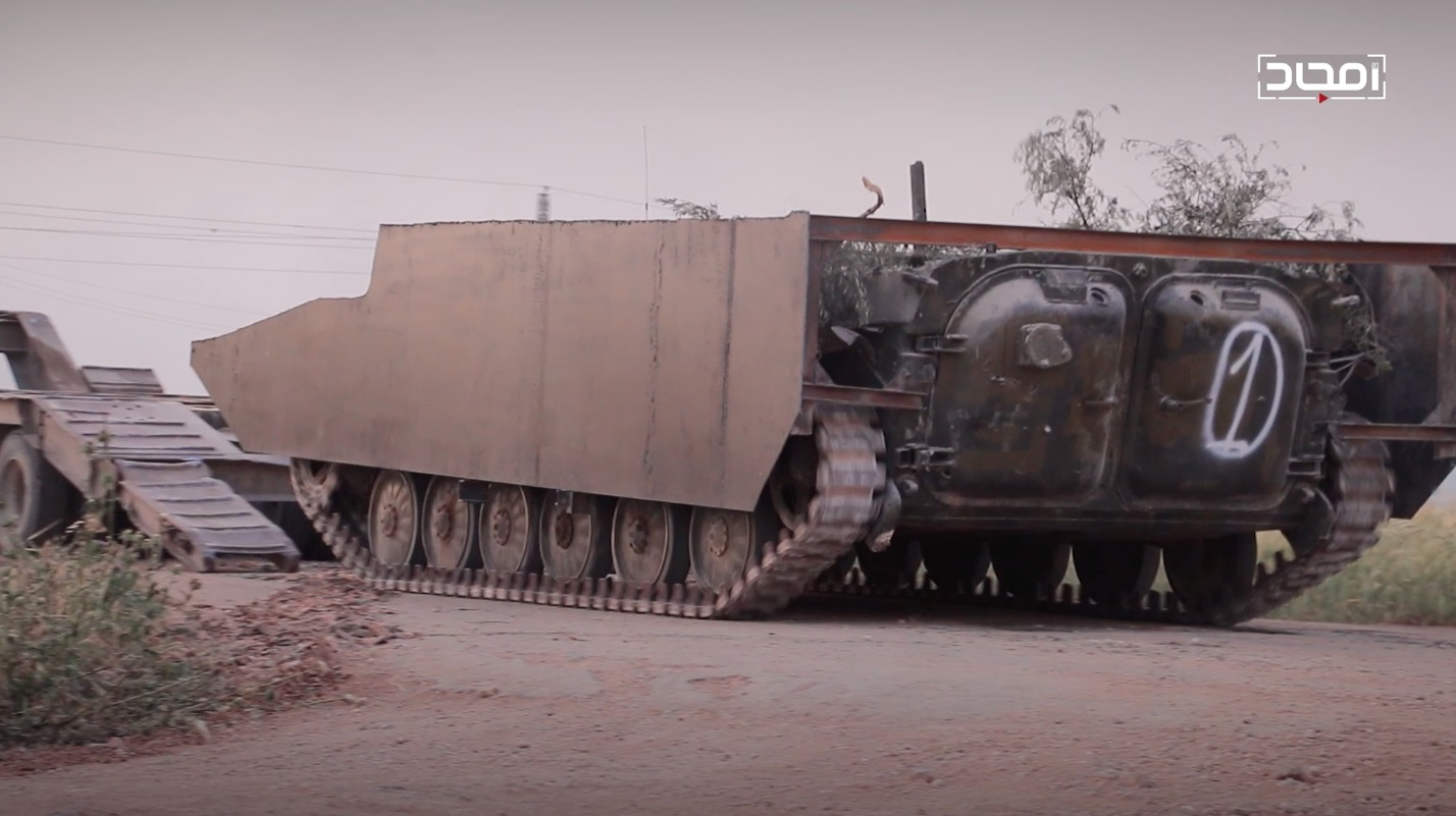 An HTS up-armored BMP-1 SVBIED that got stuck near Sakhr village southeast of Kafr Nabudah sometime between May 12 and 26, 2019, shown here in HTS media before it set off.