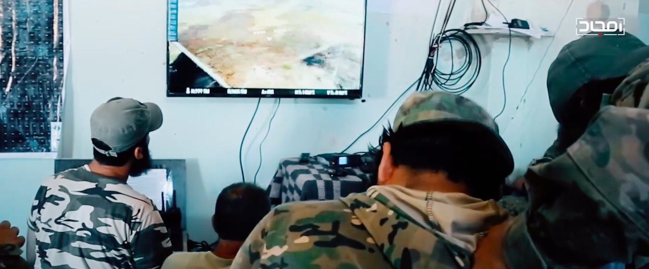 n HTS command and control center with a live drone feed on a TV monitor. From an August 2020 Amjad video.