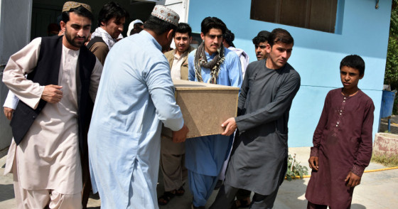 Relatives carry a coffin with the body of television journalist Nemat Rawan after he was shot dead by gunmen, in Kandahar Provicne on May 6, 2021.